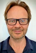 Simon Banks Headshot